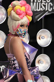 Nicki Minaj added some serious color to her platinum bouffant with pink and yellow curls at the 28th Annual MTV Video Music Awards.