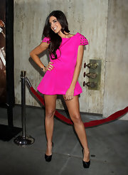 Electra paired her hot pink Naven dress with black platform pumps.