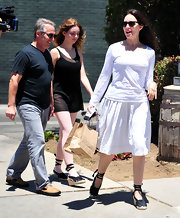 Madeleine Stowe stepped out for a sunny day in a white ensemble with a pair of black ankle-wrap espadrilles.