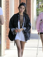 Madison Beer's peach mani added a bright spot to her look.