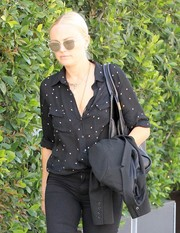 Malin Akerman accessorized with chic cateye shades while shopping in Beverly Hills.