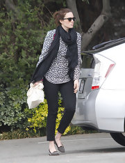 Mandy Moore tamed her leopard print blouse with a pair of cropped black jeans reminiscent of Audrey Hepburn's favorite pants.
