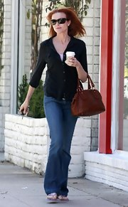 Marcia Cross was seen heading out from Starbucks carrying a tan leather tote bag.