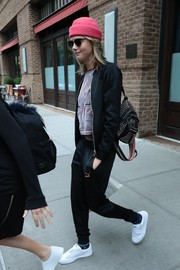 Cara Delevingne layered a black track jacket over a patterned crop-top for a day out in New York City.