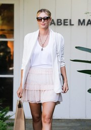 Maria Sharapova hid her eyes behind a pair of oversized cateye sunglasses while shopping in West Hollywood.