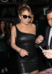 Mariah Carey teamed her leather dress with a pair of wayfarers for a night out at Mr. Chow.