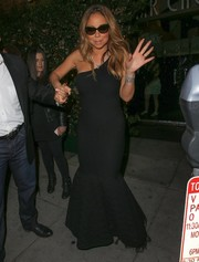 Mariah Carey stepped out of Mr. Chow looking oh-so-glam in a black one-shoulder mermaid gown. All that was missing was the red carpet!