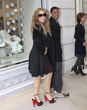 Mariah Carey did a little shopping in Paris while wearing two tone strappy sandals with striped platforms.