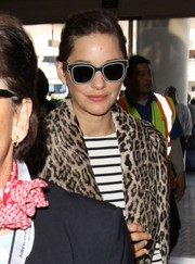 Marion Cotillard was spotted at LAX rocking super-funky black-and-white wayfarers.