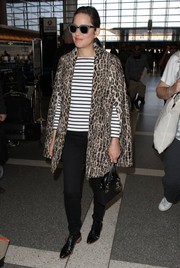 Marion Cotillard brought a dose of glam to LAX with this leopard-patterned fur coat.