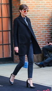 Marion Cotillard looked cool in her polka-dot skinny jeans and black coat as she left her NYC hotel.
