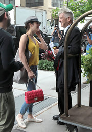 Marion Cotillard put a spin on a classic with this hot pink quilted bag.