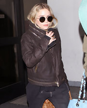 Ashley Olsen channeled John Lennon with a pair of round metal-framed sunglasses.