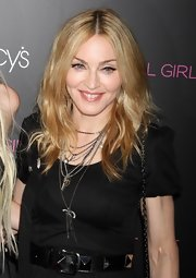 Making an appearance at the collection launch of Material Girl, Madonna showed she's still got it. Her center part locks were radiant!