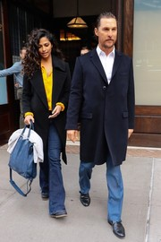 Camila Alves chose a blue suede tote by Draper James for her arm candy.