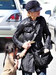 Meg Ryan made a rare appearance out and about Santa Monica with Daughter Daisy. She showed off her casual style with her black cross body bag and newsboy hat.