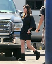 Megan Fox was spotted on set in a black wrap dress with kimono style sleeves.