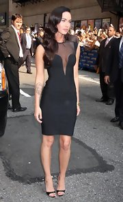 "Megan Fox showed some skin on the ""Late Show With David Letterman"" in a black bodycon dress with sheer insets."