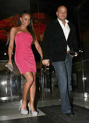 With her newly shaved hair, Mel B and her husband are seen departing from Katsuya. She looks ready for summer in a pink strapless dress and grey platform pumps.