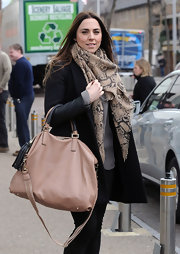 Mel C wore a lovely snake print scarf while out and about in London.