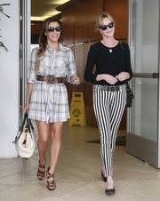 Eva Longoria was out and about in Beverly Hills looking casual-chic in brown strappy sandals and a plaid shirtdress.