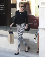 Melanie Griffith showed off her street style with a pair of black-and-white striped pants and a sweater while out and about in Beverly Hills.