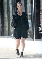 Mena Suvari kept her daytime look crisp and clean with this black romper.