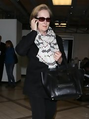Meryl Streep dressed up her travel look with this Southwestern-inspired patterned scarf.