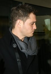 Michael Buble bundled up in Berlin in a gray wool scarf.