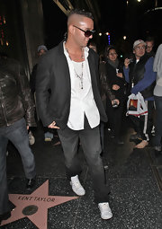 Mike wears a classic black blazer over a white button-down and jeans while out in LA.