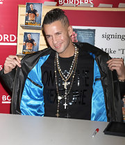 Mike wears a black t-shirt under his blue-lined leather jacket at his book signing.