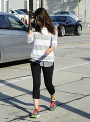 Mila Kunis paired her top with cropped black leggings.