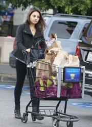 Mila Kunis donned a pair of black Rag & Bone ankle boots and a moto jacket for a day of shopping.