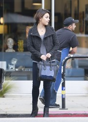 Mila Kunis went grocery shopping carrying a chic Celine tote.