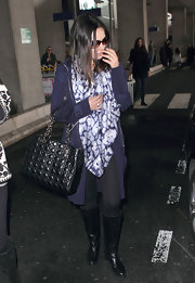 New Dior spokesperson, Mila Kunis, carried one of the brand's black quilted totes to the airport.