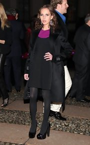 Allegra Versace made a simple appearance in an all black ensemble, which was accented in purple. Her patent leather platform heels were super cute, but she didn't look to happy about it.