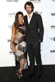 Margherita Missoni looked oh-so-glam at the 2010 amfAR Milano event in black evening sandals and a glittery dress.
