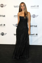 Adding to the throngs of celebs showing up in black gowns. Leona Lewis attended the amfAR party in a lace embellished strapless gown.