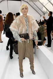 Paola Barale exuded an avant-garde vibe with her metallic gold harem pants, print blouse, and fur cape.