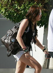 Miley can fit all her bracelets in this brown leather oversized satchel.