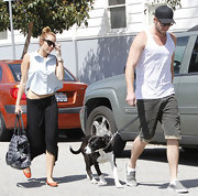 Liam Hemsworth looked like a true California boy in his tank and slip-on sneakers.