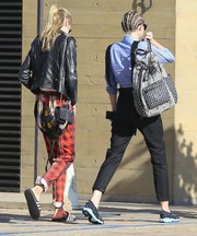 Miley Cyrus looked just like a college student when she sported this mixed-print backpack and overalls combo in Malibu.