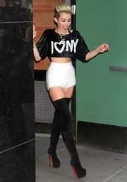 Miley paired her cropped top with these fuzzy white shorts.