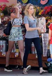 Miley Cyrus stepped out in a money print crop top and matching mini skirt for a casual trip to the grocery store.