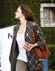 Minka Kelly hit the salon carrying a cognac studded Alexander Wang purse. SHe paired the purse with a gray open front cardigan.