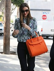 Miranda Kerr's print blouse was a fun and quirky look for the model and mom.