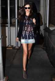 Miranda Kerr wore this mini denim skirt with ankle boots for a dentist appointment.