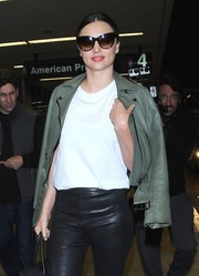 Miranda Kerr kept her eyes hidden behind a pair of oversized cateye sunnies by Samantha Wills as she made her way through LAX.