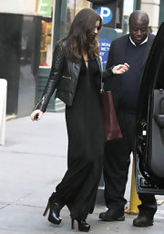 Miranda Kerr showed off her style savvy in black leather lace-up ankle boots.
