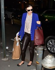 Miranda Kerr complemented her blouse's girlish heart print with a matching wine red leather tote.
